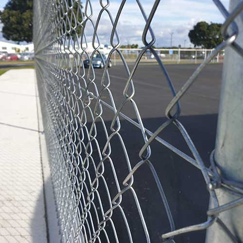 Coiled Wire in chain link netting fence